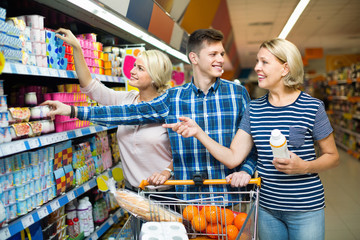 Happy family choosing dairy products and smiling