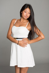 Beautiful Asian girl in white dress
