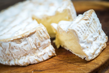 Slice camembert cheese rustic wooden table