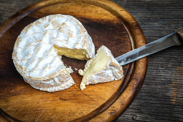 Camembert cheese with knife