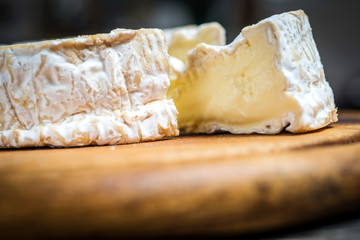 SLice of camembert cheese  rustic table
