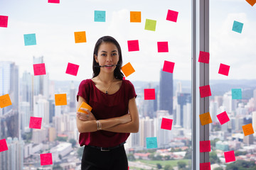 Busy Business Woman With Pen In Mouth And Adhesive Notes