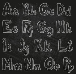 Handwritten chalk alphabet in sketch style A-P on black grunge b