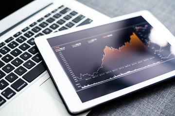 Stock market chart on digital tablet pc