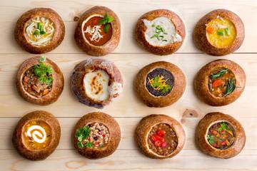 Twelve Soup Varieties Served in Bread Bowls
