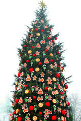 Christmas fir tree decorated with toys outdoors