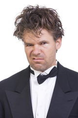 Deranged angry man in a tuxedo