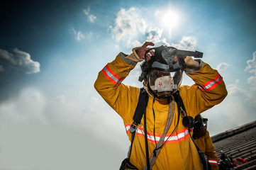 Firefighter with mask and airpack fully protective suit