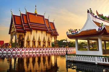 Thailand Landmark. Scenic View Of Buddhist Pagoda At Sunset. Temple Complex Wat Phra Yai ( Wat Plai Laem ), Big Buddha Temple At Koh Samui. Travel, Tourism. Oriental Architecture. Landscape Background