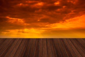 Empty wooden table and beautiful summer sunset in background. Gr