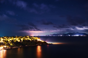 Thailand Landscape. Tropical Coast ( Koh Samui Island ) At Night Time With Dark Sea, Beautiful Purple Sky And Beach Lights. Nightlife, Night View. Summer. Travel On Vacations To Asia. Tourism.