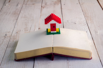 house model on blank page notebook