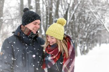 family couple walk winter snow