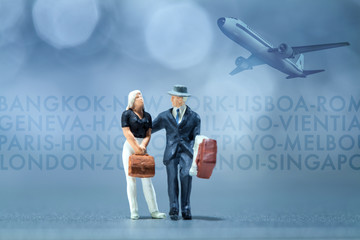 Miniature people - a businessman and businesswoman waiting in the airport lobby