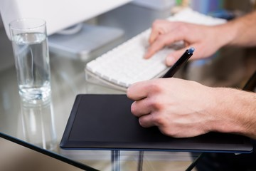 Cropped image of man using graphic tablet