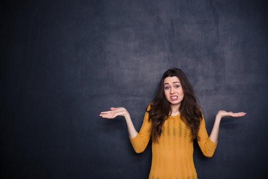 Young woman shrugging shoulders