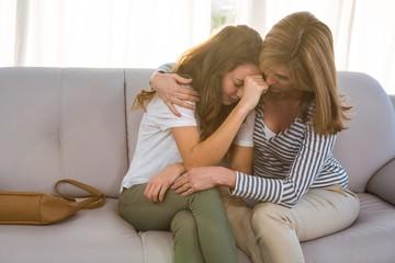 Mother comforting her teenage daughter Wall mural