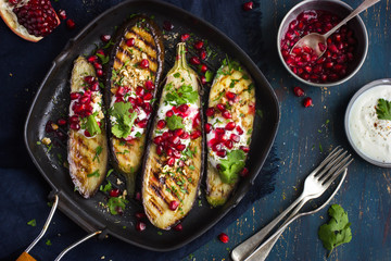 grilled eggplants with garlic yogurt sauce, walnuts and pomegran
