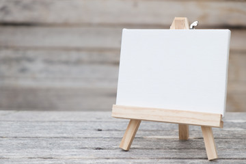 canvas photo frame on wooden table