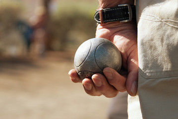 Senior playing petanque,fun and relaxing game