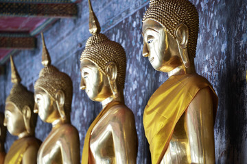 The row of golden buddha image in sitting attitude
