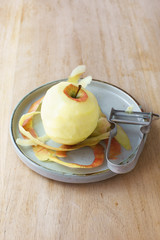 Peeled apple and speed peeler
