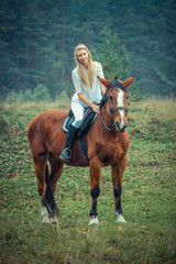 romantic sensual girl  on a horse in the forest