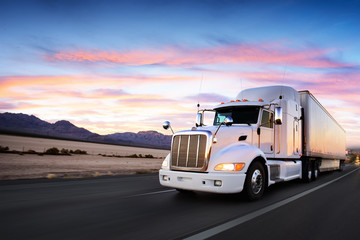 Truck and highway at sunset - transportation background Wall mural
