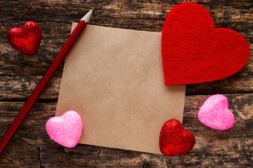 Background on Valentines Day heart pencil and a note on a wooden background mockeup