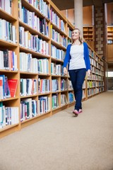 Female student walking in the library