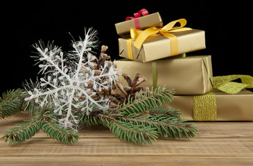 branch of fir-tree and gifts to Christmas