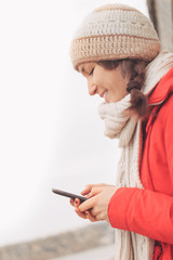 Young woman using smart phone chatting