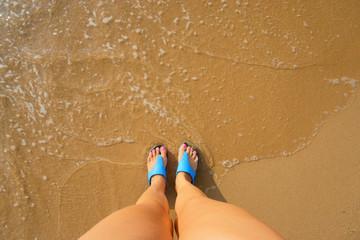 female foot in flip flops