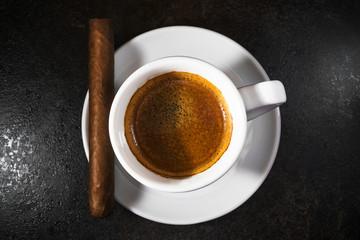 Cigar with an espresso coffee