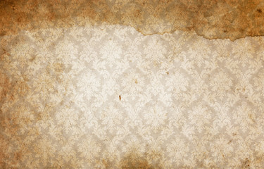 Old dirty paper background with old-fashioned ornament.