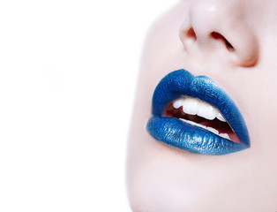 Woman lips with glossy blue lipstick