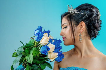 beautiful bride in blue dress with bouquet of flowers. blue and white roses