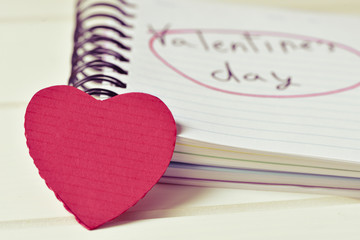 red heart and text valentines day in a notebook, filtered