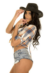 cowgirl short denim shorts in hat hands by face