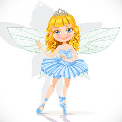 Beautiful little fairy girl in tiara and blue dress isolated on