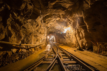 Underground gold mine tunnel with rails