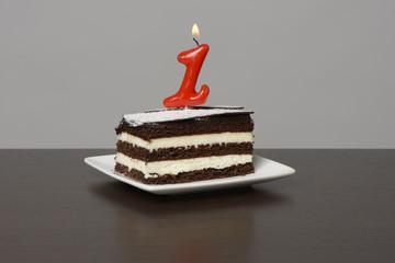 Pastel con vela número uno 1