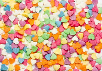 Sugar sprinkling hearts of different colors close-up