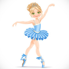 Beautiful ballerina girl dancing in blue dress