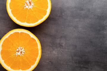 Orange slice on the grey  background.