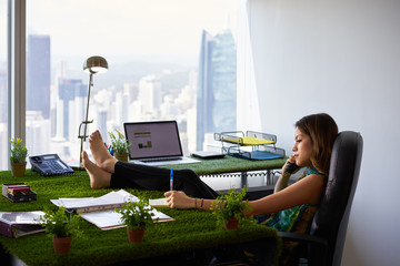 Environmentalist Woman Writes Note Barefeet On Office Desk