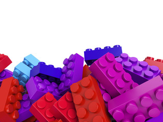 Multicolored toy plastic bricks background