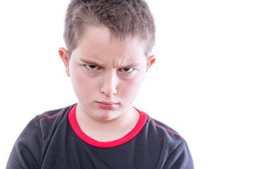 Tween Boy Frowning Disapprovingly at Camera