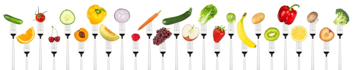row of tasty fruits and vegetables on forks isolated on white background
