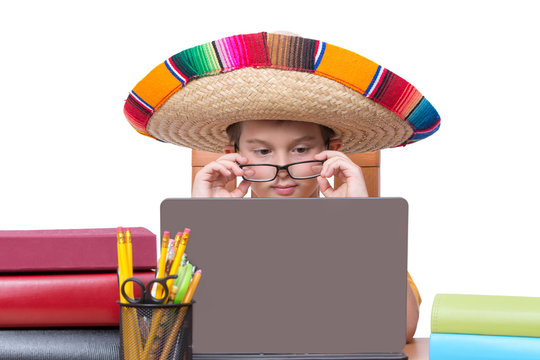 Boy Wearing Glasses and Sombrero and Using Laptop